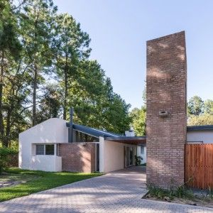 Biagioni Pecorari adds brick water tower to remodelled house in Argentina