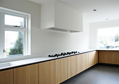 White HI-MACS kitchen top with Pitt Cooking burners by NOMAA|architectuur & interieur.