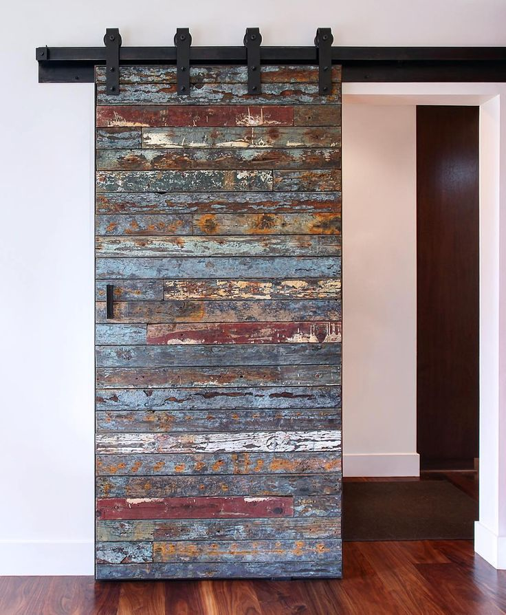 """This is not your ordinary barn door. Salvaged marine wood from a 40 year old bait barge which was destroyed by a swell in the Pacific Ocean from the 2011 Tsunami that hit Japan. We were lucky to get the remaining pieces to create this one of a kind sliding door!""-@melissamorgandesign  Hung with our Industrial hanger."