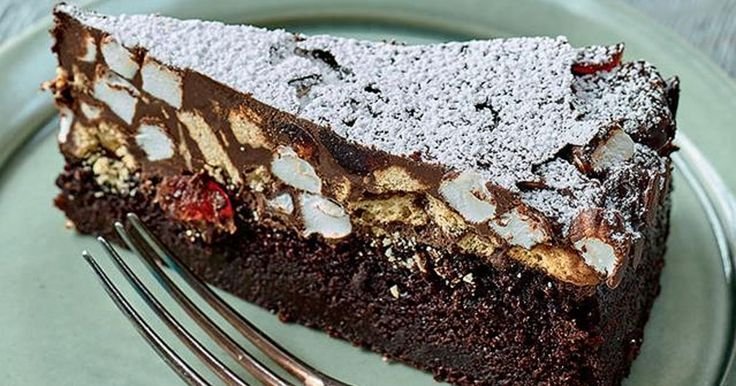 Nadiya Hussain's rocky road cake is a real winner of a recipe. The gooey rocky road topping is perfect with the luxurious chocolate cake underneath. Delicious!