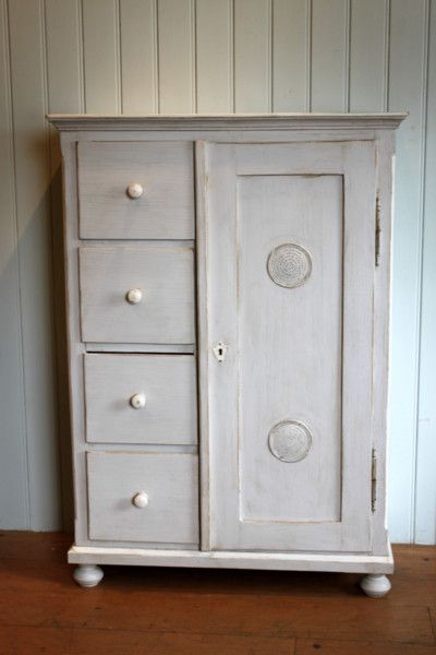 Continental painted pine storage cupboard