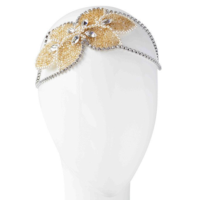The Sofia Bridal Halo is inspired by the talented and iconic Sofia Loren. Striking, elegant, and sophisticated.Sofia is an exquisite and understated headpiece. She is elegant, romantic and glamorous. She is handcrafted with the brilliance of Swarovski Crystal Rock (Yummii