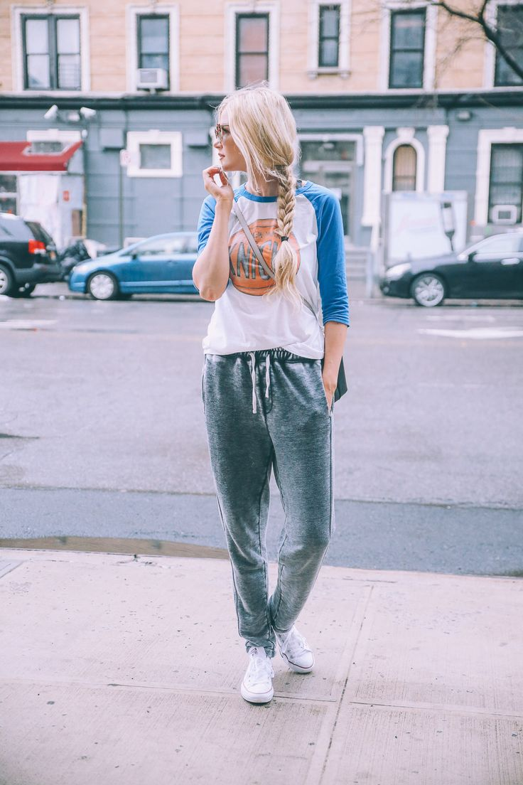 Amber Fillerup Clark keeps it cool and casual in this combination of a graphic baseball tee and acid wash style joggers. We love how this look is both comfortable and still street ready! Joggers: Topshop, Shoes: Converse.