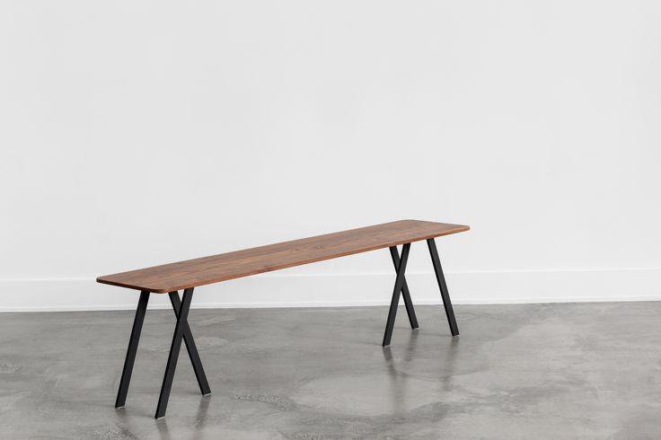 C110 solid walnut bench with subtle curves and black steel base / Banc C110 en noyer massif avec de légère courbe avec base en acier noir