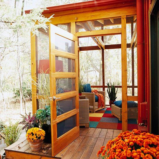 A compact porch deftly segues a house from outside to inside spaces. Porches needn't be large; a small screened area can provide a nice transition to either a front or back space, as this intimate room does. A five-panel door offers a rich design statement for the porch's entry. Planks on the floor visually connect the porch spaces with the exterior stairs. Since the wood frames on the porch are stained, accent colors in the furnishings pick up the accent colors on the house Protect a porch…