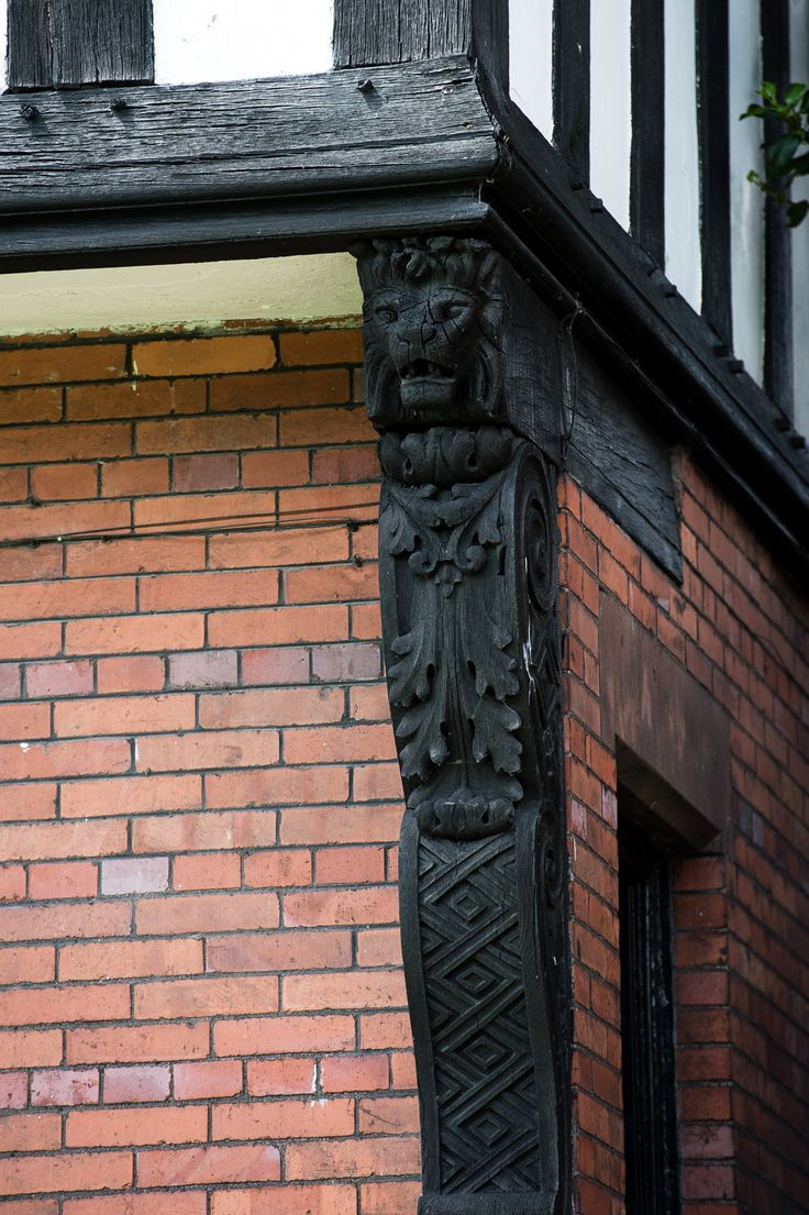 Decorative timber corbel with lion design on Park Road.  Design by William Owen, 1892.