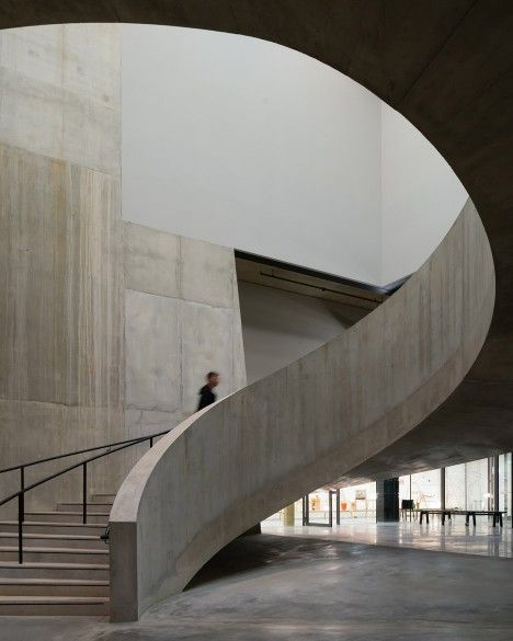 Curved concrete staircase inside Herzog & de Meuron's Tate Modern extension
