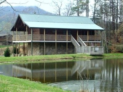 Fishing hole fish from the deck and have a bombfire for Gatlinburg cabins with fishing access
