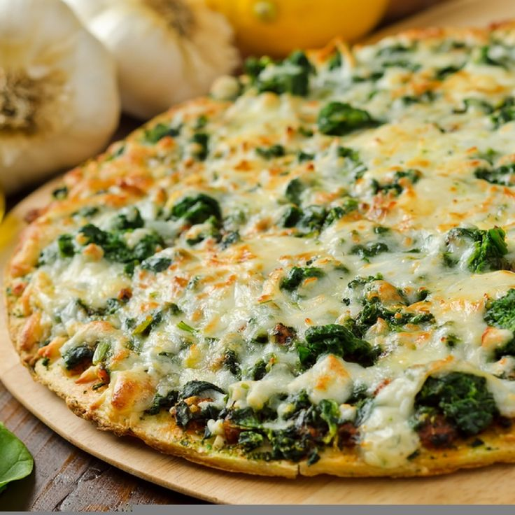 This spinach pizza is so tasty.  The recipe has a homemade crust and you can use fresh spinach or frozen.. Spinach Pizza Recipe from Grandmothers Kitchen.
