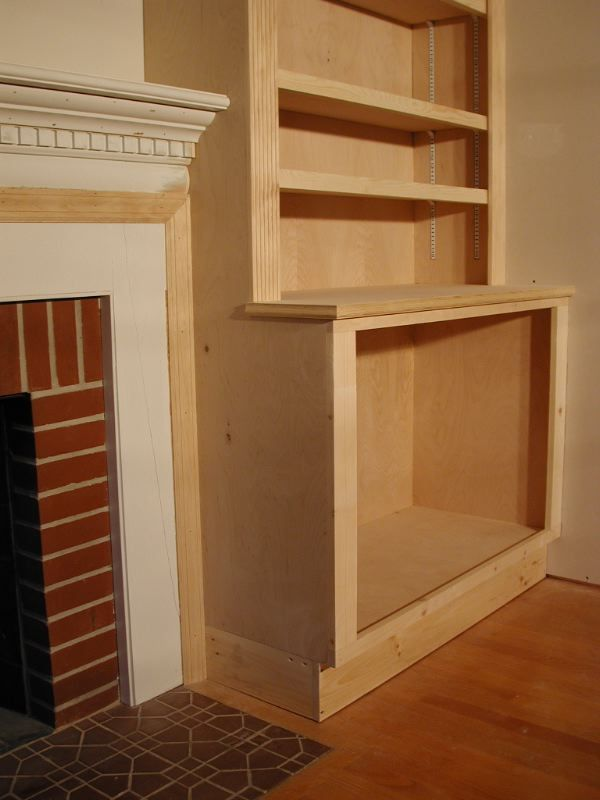 Picture of how to build cupboard beside fireplace