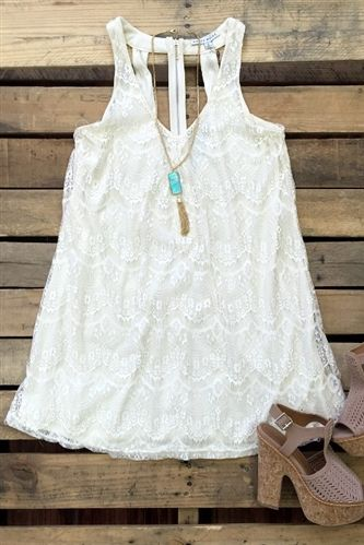 Our Sunday Brunch Dress - Ivory is lovely! Its a v-neck lace dress with a cut out back with a zipper. It is fully lined.