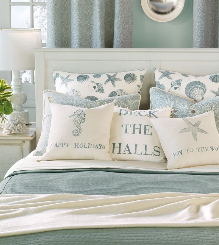 The colours and arrangement of bedding!! Not bothered by the writing. EA Holiday - Luxury Bedding Collections, Beach Holiday
