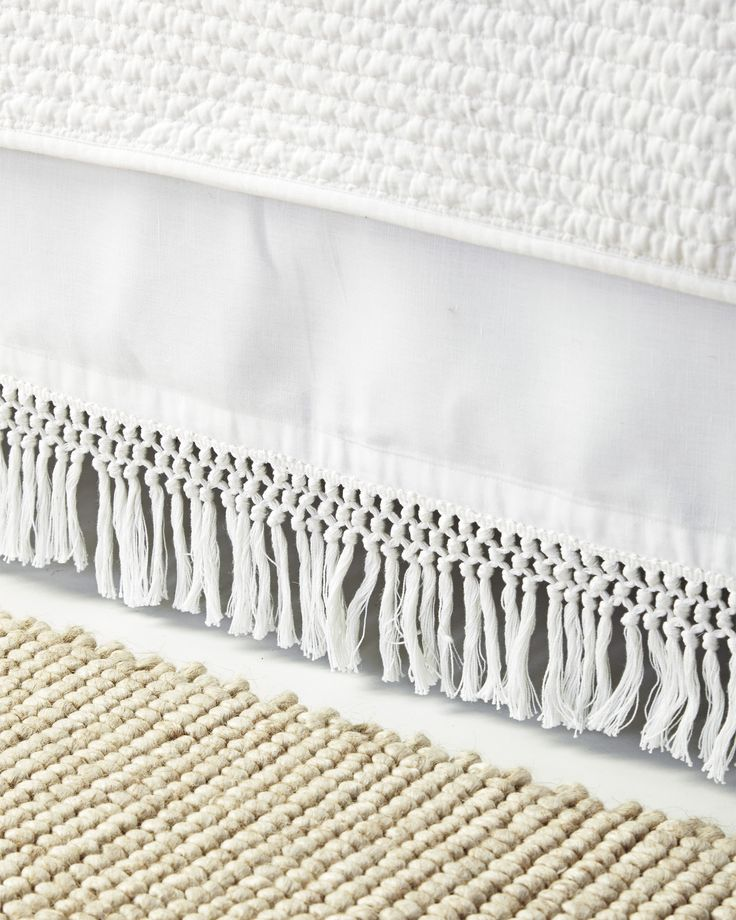 We can't resist a fabulous fringe, and we adore the way this adds texture to the bedroom in an unexpected way. A blend of linen and cotton gives it the perfect balance of drape and structure.
