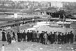 Fans observe a game at the Polo Grounds from Coogan's Bluff, 1908