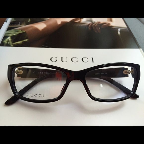 Gucci Eyeglasses, authentic as usual. NIB  Authentic Gucci eyeglasses in black plastic material. Made in Italy.  Comes with the original Gucci case, Gucci cleaning cloth too. Brand new, no scratches and beauuutiful! Just does not look good on me as I hoped it would. Size 53 with adjustable ear pieces.  Gucci Accessories
