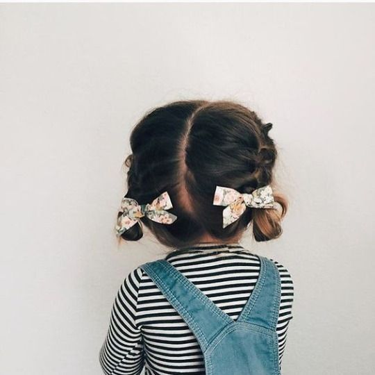 Toddler hairstyle for girls: Cute braided hairdo! The two french braids are a great idea for a little one whose hair isn't long enough for regular braids. Up do for short hair baby hair.