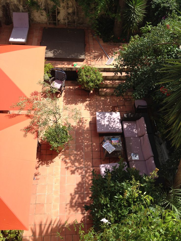 View from the top of the courtyard with a sofa, hot tub and everything that is needed to relax!