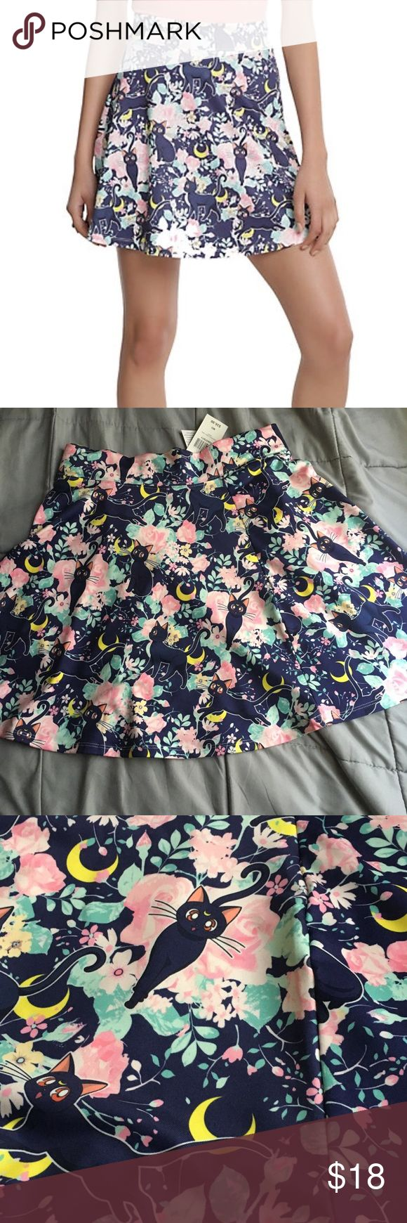 """SAILOR MOON LUNA FLORAL CIRCLE SKIRT 🌙✨ Transform from your clumsy daytime self into your heroic (and super cute) Sailor self with the help of this Luna crescent moon circle skirt! Sailor Moon is proof that a black cat from the Moon Kingdom is a girl's real best friend. Bonus: Tuxedo Mask will approve of the roses...he's all about roses. 95% polyester, 5% spandexWash cold; line dry17 1/2"""" longImported Hot Topic Skirts Circle & Skater"""