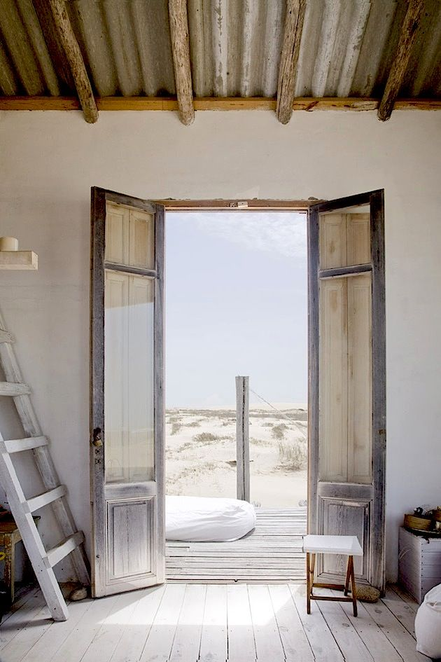 beach house ... so white with punches of hard colour. love the corregated iron roof...and sun bleached silvering wood door frames