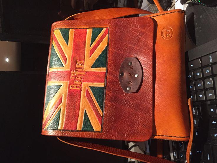 Vertical leather messenger bag.