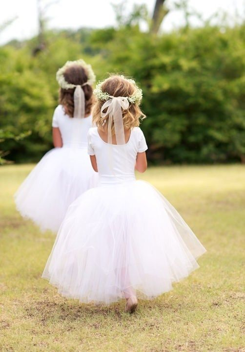I saw these at a wedding in Arizona this weekend.  They were homemade tutu's and white leotards.  They were very cute.  Kids had to take of the tutu's though because they were itchy.
