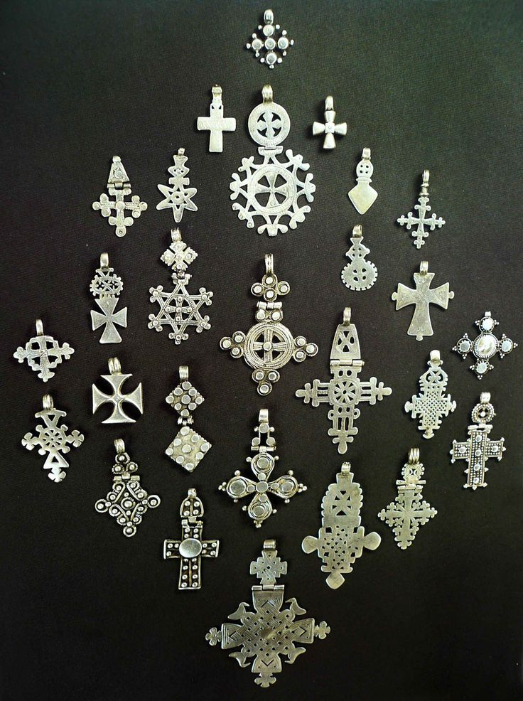 "Africa | ""Ethiopian crosses, usually named after towns or provinces of the highlands, are either cast by lost wax method or cut directly from a Maria Theresa dollar"" 