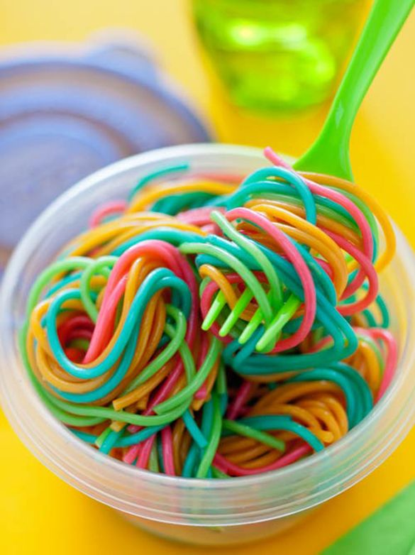 Rainbow pasta for kids! Add food coloring to individual pots of boiling water. Cook pasta as directed, drain and rinse separately. Toss and get ready to swirl.
