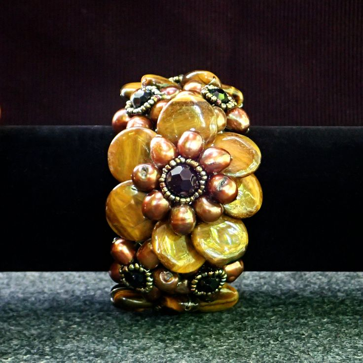 Bracelet with semi-precious tiger's eye brown freshwater pearls, black crystals on braided white metal soft base.Statement,handmade,gemstone by Menir on Etsy