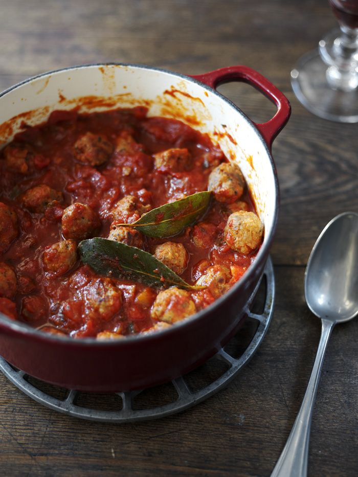 Cheaty meatballs made from sausage, squeezed out into tomato sauce makes a great family dinner.