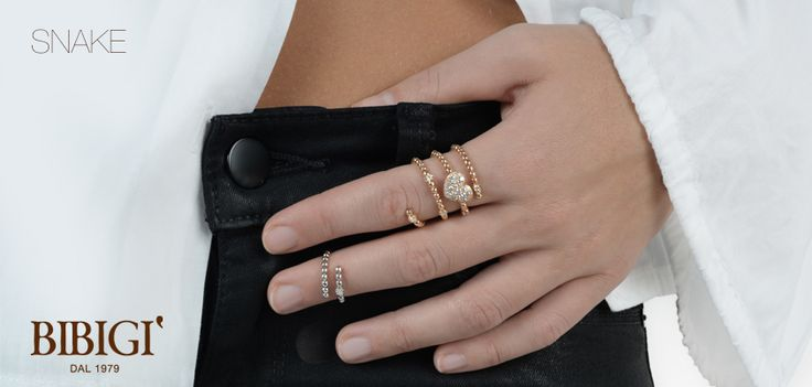 Anello - Ring Sinuosi e brillanti avvolgono dita e polsi. Sono gli anelli e i bracciali della collezione Snake di Bibigì, gioielli a forma di serpente in oro bianco, giallo e rosa impreziositi da diamanti bianchi, brown e rubini.