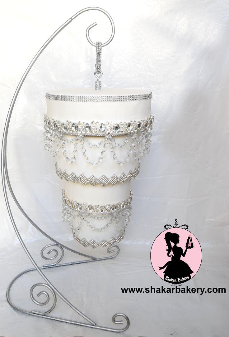 Four tier crystal chandelier wedding cake designed for a luxury bride! Hanging upside down, this cake caused one heck of a sensation! Chandelier cakes are unique and full of engineering!   www.shakarbakery.com www.facebook.com/shakarbakery