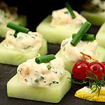 Smoked Salmon Spread  with a small piece of salmon on top... on cucumber squares... yummm.