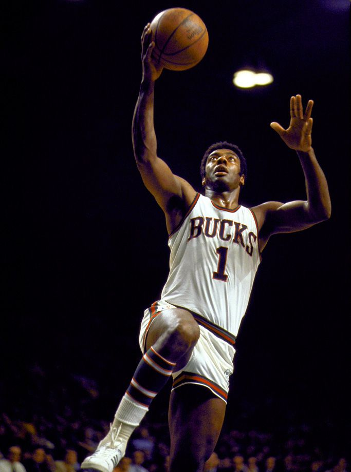 """Oscar Robertson shoots a layup during the 1971 NBA Finals between the Milwaukee Bucks and Baltimore Bullets.A 12-time NBA All-Star and Hall of Famer,""""The Big O"""" turned 77 years old today (Nov. 24). (Walter Iooss Jr. for SI)GALLERY: Oscar Robertson Through the Years"""