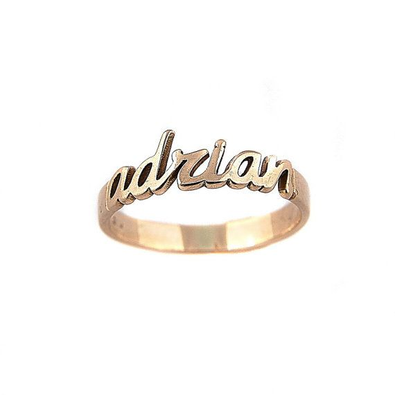 Name jewelry is always the hottest trend. This custom made name ring is beautifully crafted in solid gold 14K 585. This will certainly make a special gift making a perfect accessory for any occasion.  This name ring makes an extra elegant addition to your jewelry wardrobe.  Since your name ring is handcrafted, item may slightly vary in overall appearances than the picture shown. Each piece is custom made and is completely unique.    Personalization Requirement and Limitation:  Name must be…