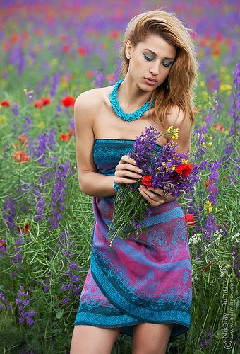 Fashion shoot with flowers of the field