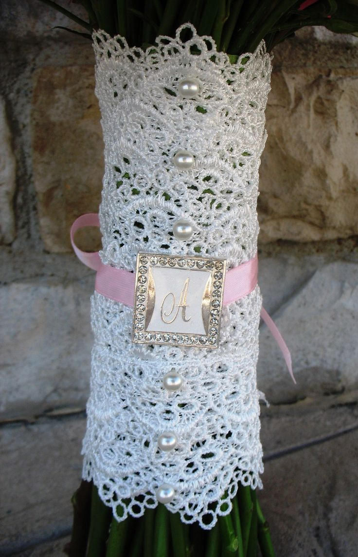 Bridal bouquet with white lace wrap, white pearls, monogram letter with ribbon.