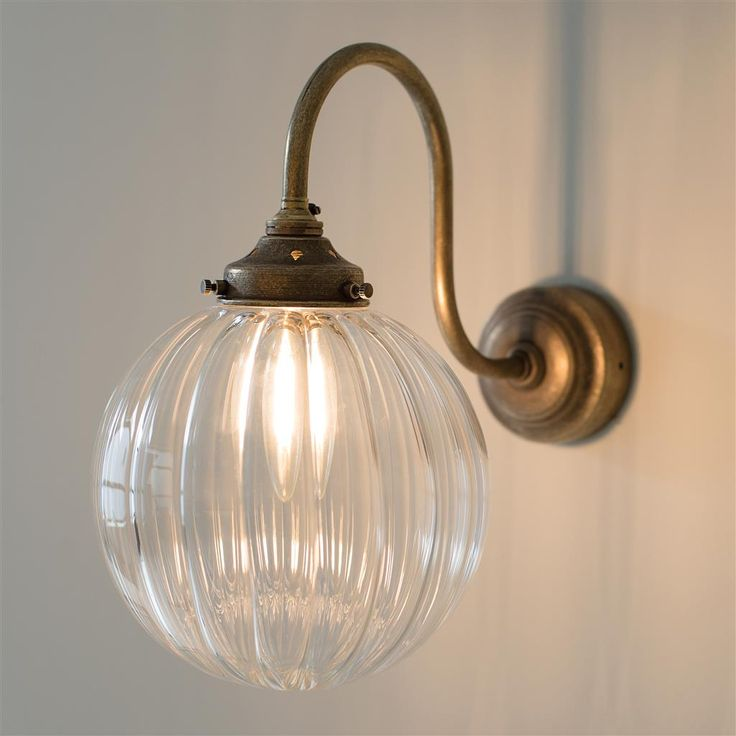 44 best lighting images on pinterest hanging lamps hanging a beautiful wall light with elegant antiqued brass curves combined with a beautiful spherical fluted glass shade suiting a period or modern home aloadofball Image collections