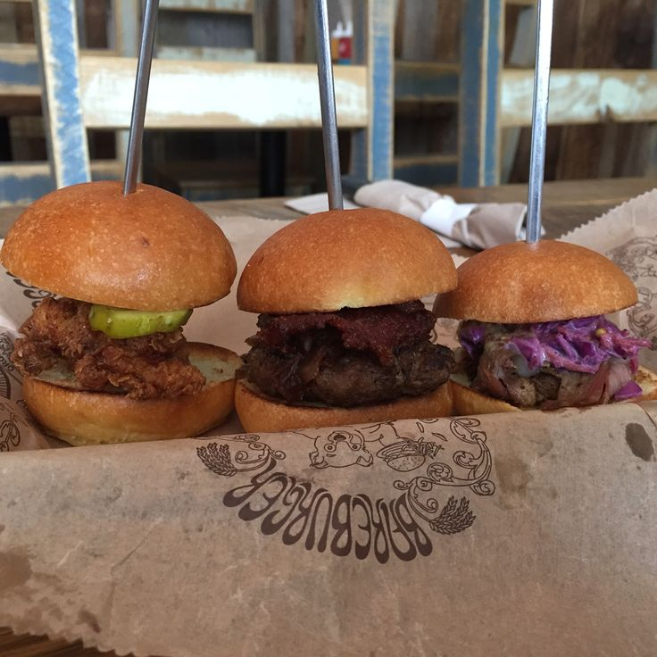 A trio of joy. Fried chicken with pickles and honey, blue burger with fig and caramelized onions and pulled brisket with prickley cabbage