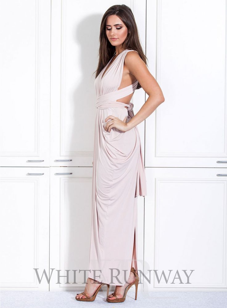 Goddess Gown. **Dresses are custom made to order so no returns are accepted on this style. Please contact us if you would like to arrange a sample order.**   A beautifully draped multi-way dress by Nicolangela. Made of a beautiful poly, spandex blend knit that can be styled over 8 different ways.