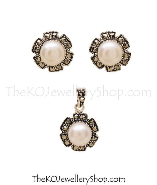 Pearl Earrings/pendant combo or set in Sterling Silver (92.5%) accented by tiny glittering Swiss Marcasite stones. Abroad shipping available. Fast delivery.