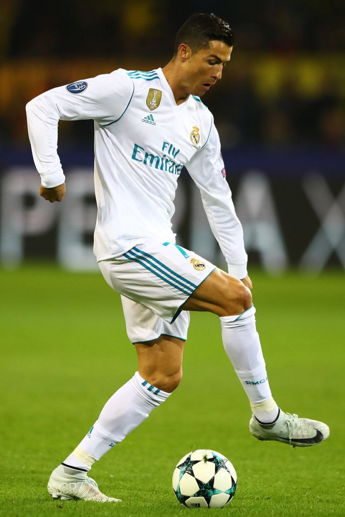 Cristiano Ronaldo Photos - Cristiano Ronaldo of Real Madrid in actionduring the UEFA Champions League group H match between Borussia Dortmund and Real Madrid at Signal Iduna Park on September 26, 2017 in Dortmund, Germany. - Borussia Dortmund v Real Madrid - UEFA Champions League