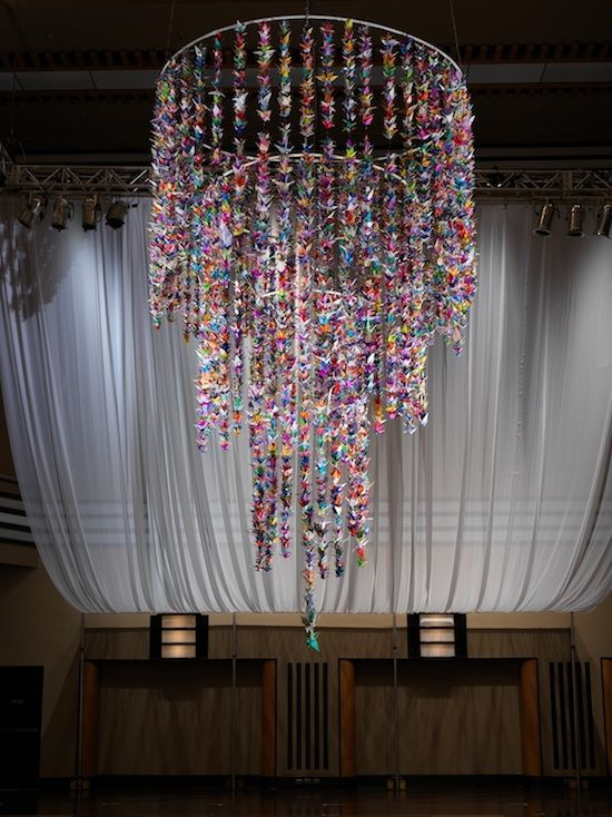 Origami Crane Chandelier made up of 14,523 paper cranes.