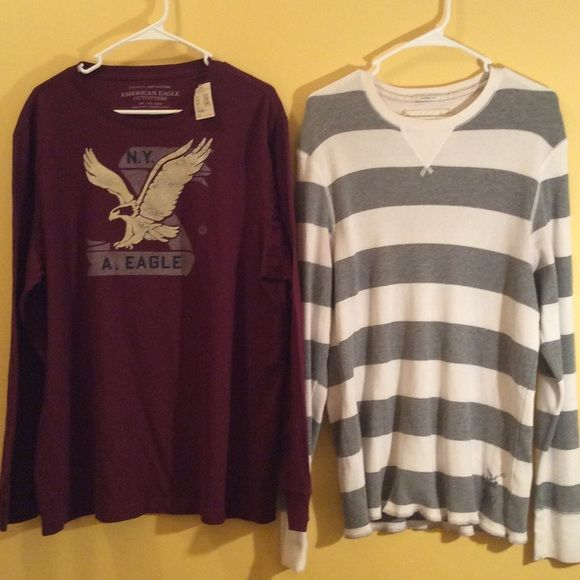 2 Mens American Eagle shirts Two Mens long sleeve American Eagle outfitters shirts. One has been gently worn and the other one is brand-new with tags's. These would make a great Christmas present for your special man. American Eagle Outfitters Tops