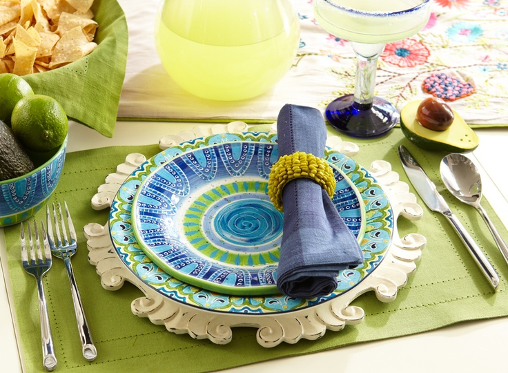 Throw the perfect fiesta with fresh summer colors -- the white chargers are so cute