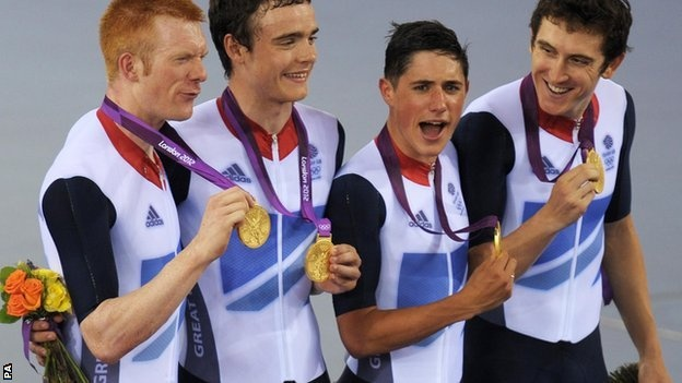 The men's team pursuit sprint team with their GOLD medals