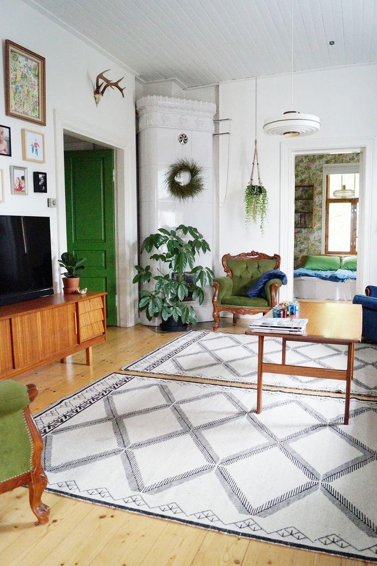 living room, old house, old furnitures, green rococo chairs,  houseplants, wool carpet,  teak coffee table, teak sideboard, retro, vintage, tilestove, green door,