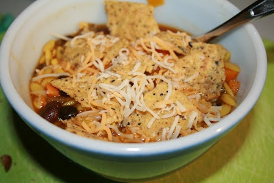 Sweet Potato, Black Bean, and Orzo Soup with a Cheesy Nacho Topping