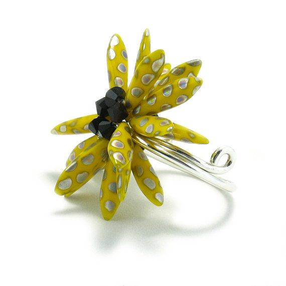 Do you know that familiar summer flower, the Black Eyed Susan? This ring replicates this flowers perky positive attitude. Ring content; Czech Glass Dagger Beads, Swarovski Crystals, and Sterling Silver Band. This ring will show your positive self. $50.00 #jewelry #handmade jewelry #fashionring #statementring #fashion