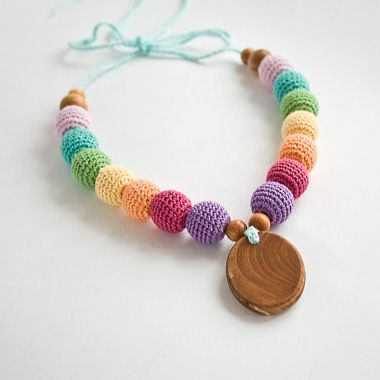 Snow Rainbow Nursing Necklace with Oval Pendant - This colorful nursing necklace features a warm pastel rainbow!