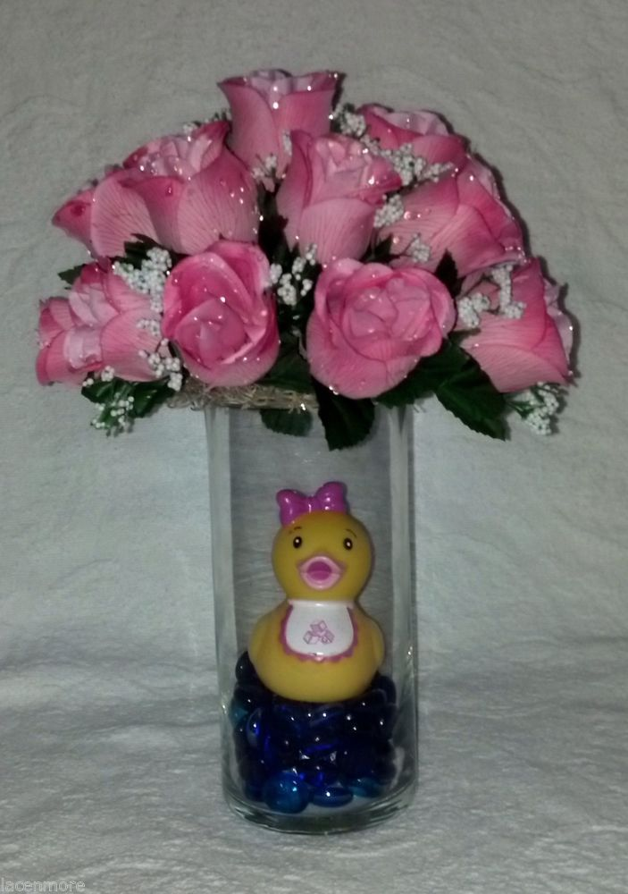 Rubber duck centerpiece for a baby girl featuring pink for Baby shower flower decoration ideas